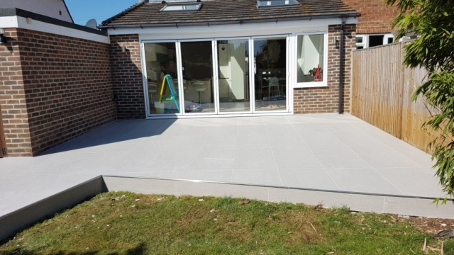 Raised patio created using Valverdi outdoor tiles and stainless steel trim.