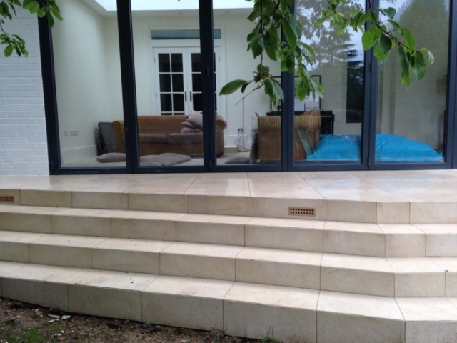 Indoor outdoor living with external steps created using Valverdi anti-slip porcelain outdoor tiles.