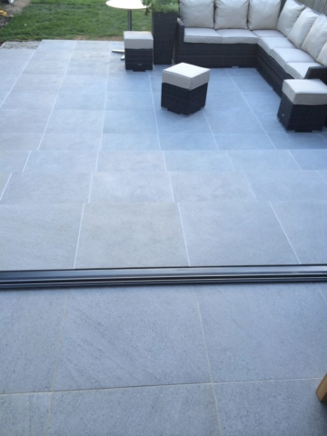 Valverdi indoor and outdoor tiles used to create a matching patio and kitchen.