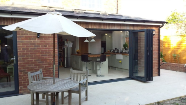Valverdi tiles used to create an indoor outdoor kitchen and patio with island and bifold doors.