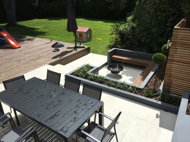 Wooden deck and Valverdi outdoor tiles used in contemporary garden design.
